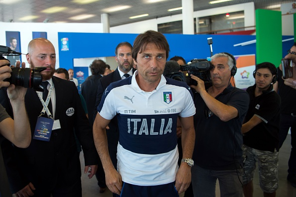 Italy's coach Antonio Conte (C) leaves a press conference following the defeat against Germany at the base camp in Perols near Montpellier on July 3, 2016 during the Euro 2016 football tournament.  / AFP / BERTRAND LANGLOIS        (Photo credit should read BERTRAND LANGLOIS/AFP/Getty Images)